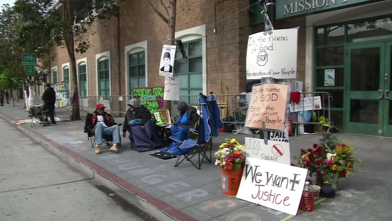 This image shows the Frisco5, five hunger strikers, outside of the Mission District Police Department in San Francisco on May 4, 2016.