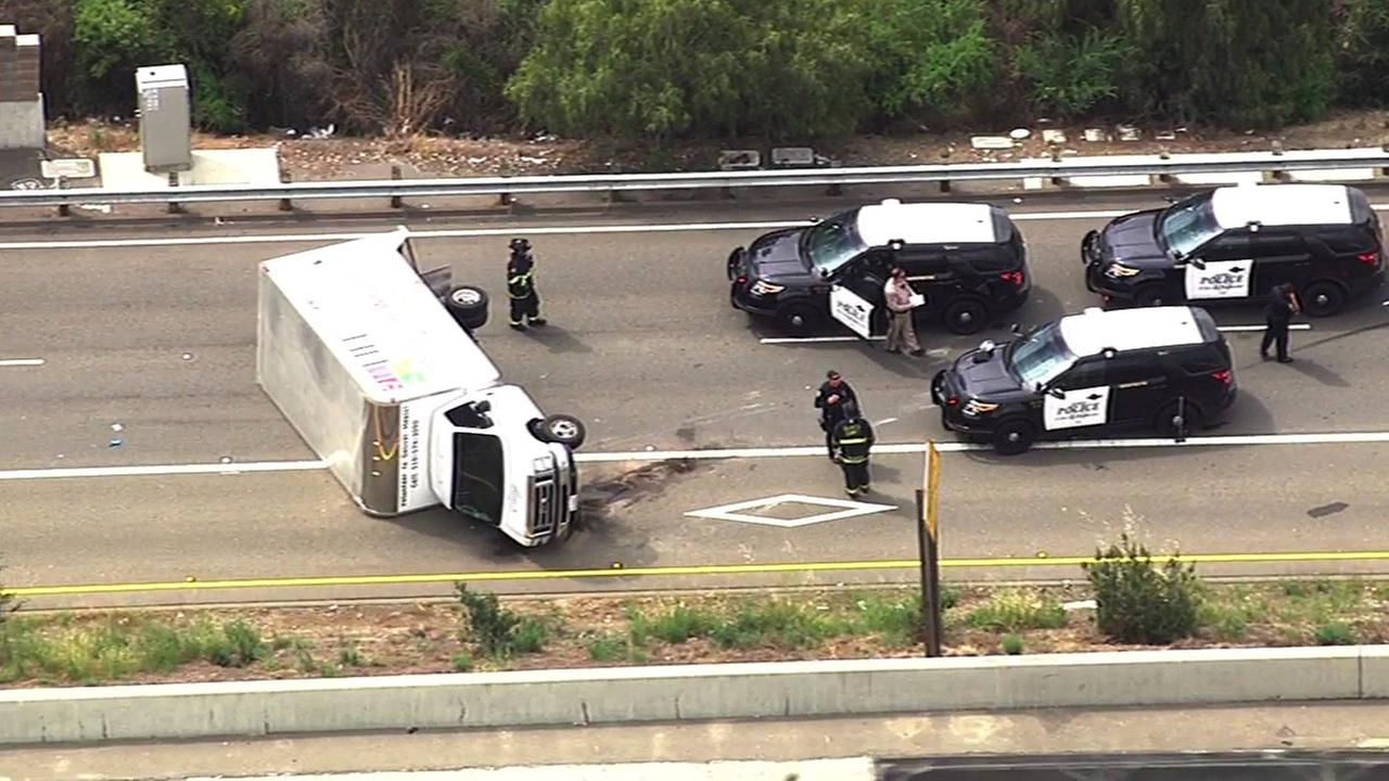Police investigate van crash on I-580 in Castro Valley, California, Thursday, May 5, 2016.
