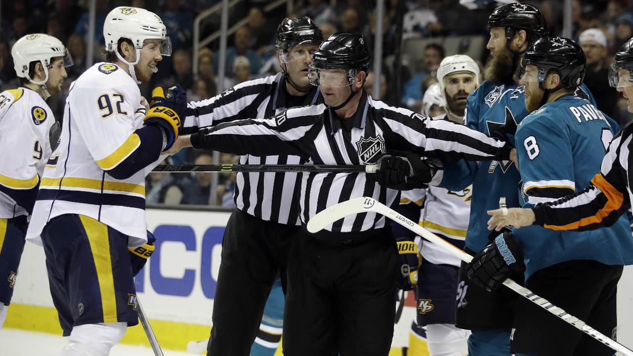Nashville Predators Ryan Johansen is separated from San Jose Sharks Joe Thornton and Joe Pavelski during Game 5 in an NHL hockey Stanley Cup Western Conference semifinal series Saturday, May 7, 2016, in San Jose, Calif.