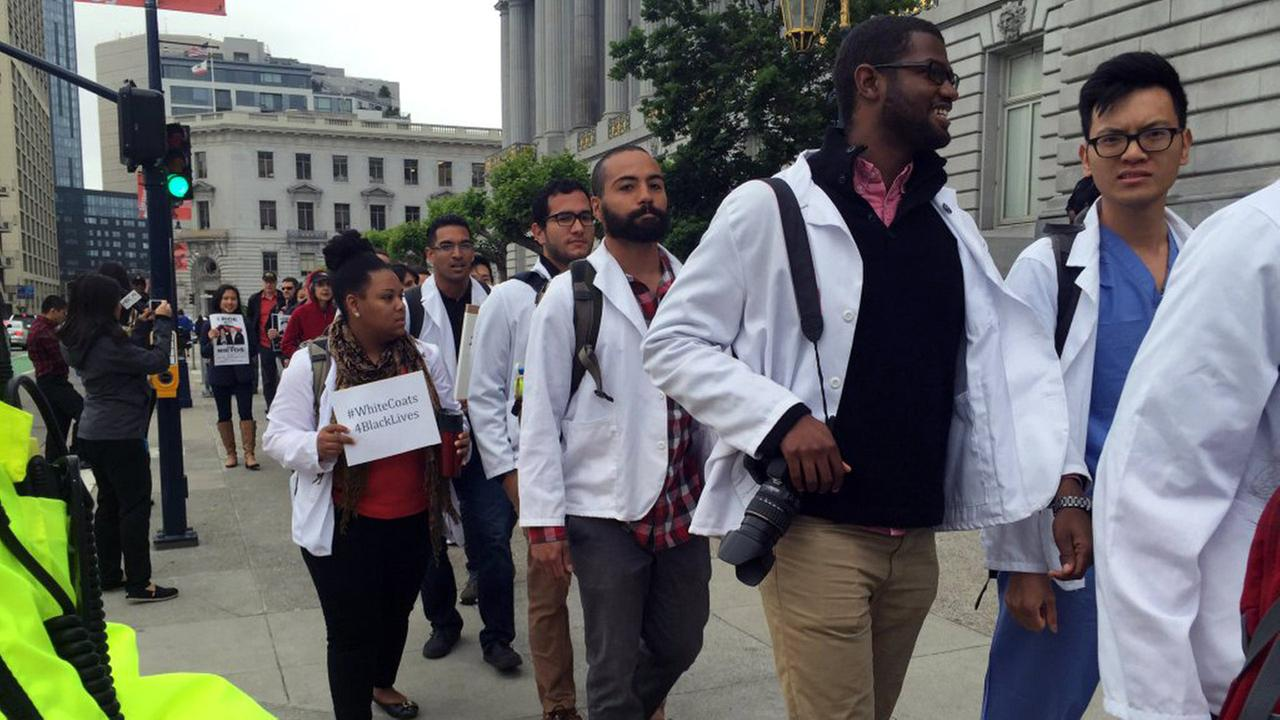 Several UCSF medical students came out to San Francisco City Hall in support of Frisco Five protest, Monday, May 9, 2016.