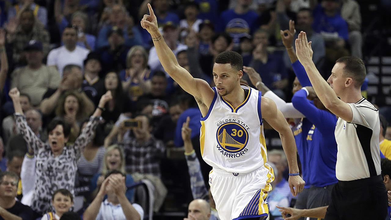 FILE - In this April 3, 2016, Warriors Stephen Curry celebrates a score during a basketball game against the Trail Blazers in Oakland, Calif. (AP Photo/Ben Margot, File)