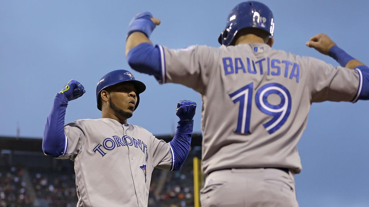 Blue Jays Edwin Encarnacion celebrates with Jose Bautista after hitting a two run home run off Giants Jake Peavy during a game on May 9, 2016, in San Francisco. (AP Photo)