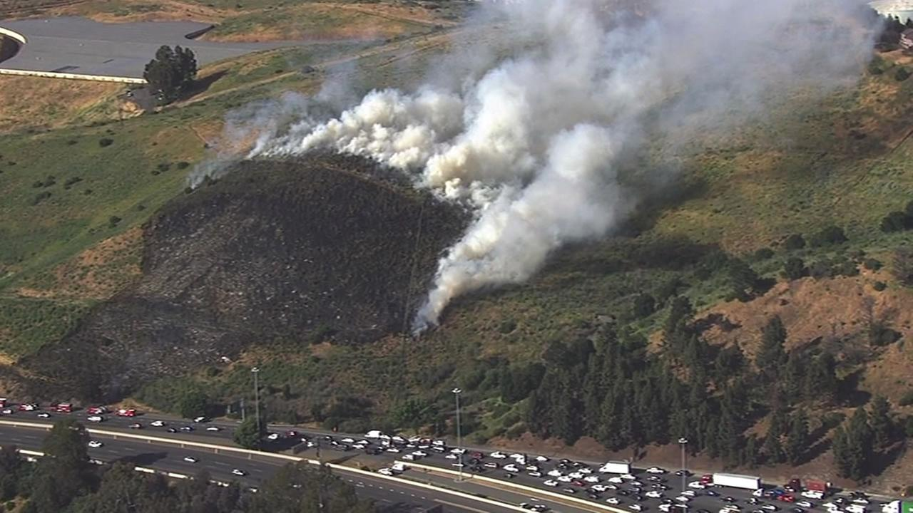 A two-alarm grass fire is burning near I-80 in Vallejo, Calif. on May 11, 2016.