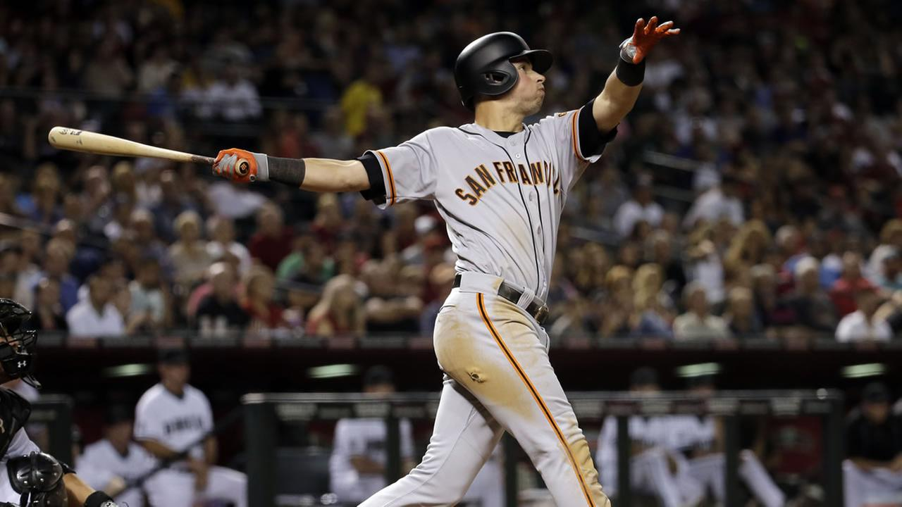 San Francisco Giants Joe Panik watches his three-run home run take flight against the Arizona Diamondbacks during the sixth inning of a baseball game, Friday, May 13, 2016.