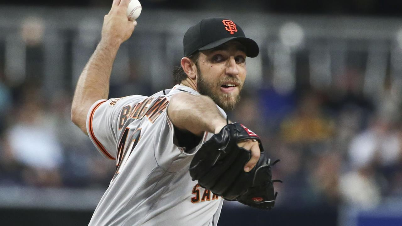 Giants starting pitcher Madison Bumgarner throws against the San Diego Padres during the first inning of baseball game Tuesday, May 17, 2016, in San Diego. (AP Photo/Lenny Ignelzi)