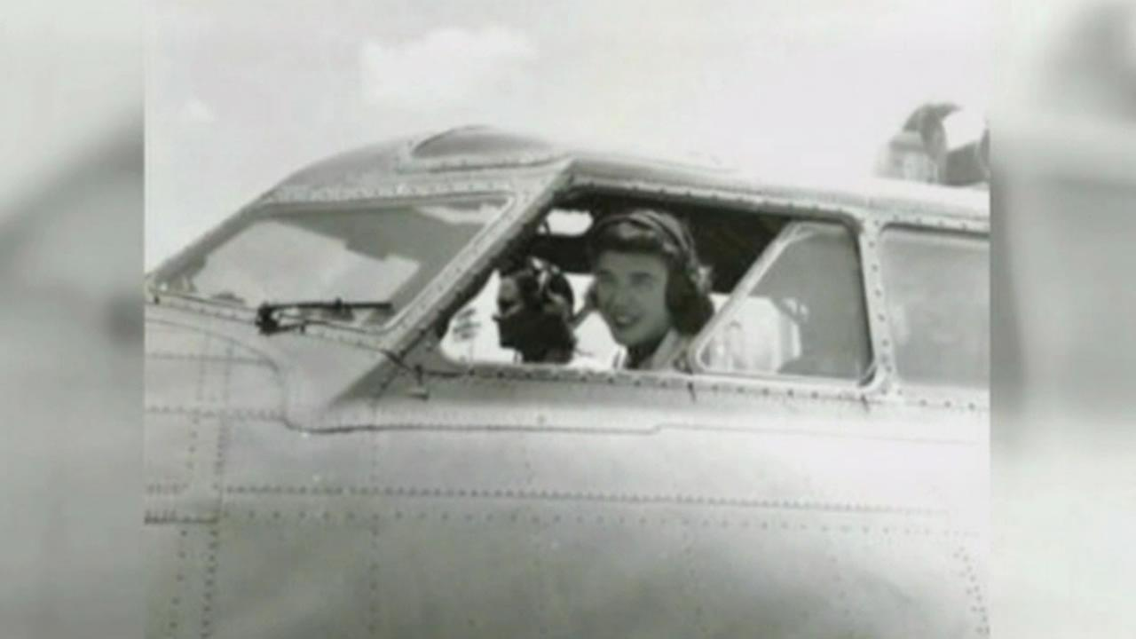 This image shows a female World War II pilot. The WASPs were recently allowed burial at Arlington National Cemetery.
