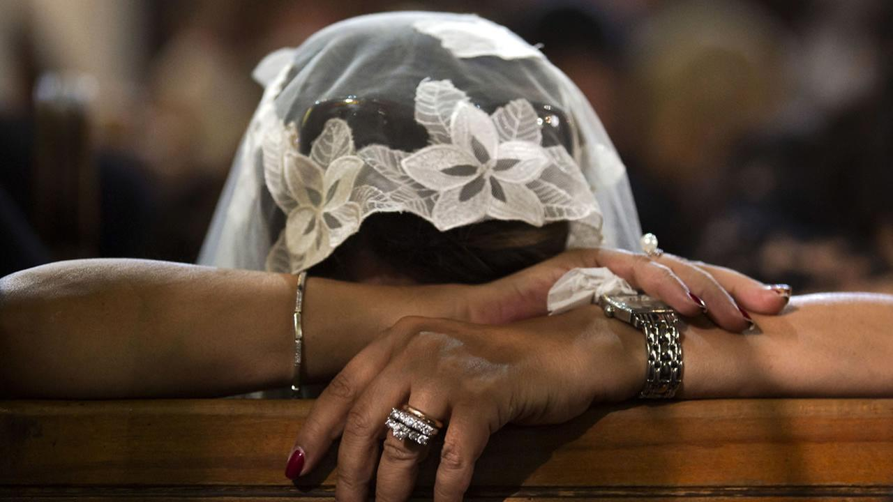 A Coptic Christian grieves during prayers for the departed at the main Coptic Cathedral complex, in Cairo, Egypt, Sunday, May 22, 2016.