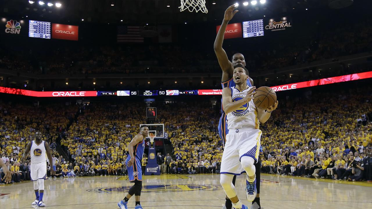 Golden State Warriors Stephen Curry, right, drives past Oklahoma City Thunders Kevin Durant, behind Curry, in Game 5 of the NBA basketball Western Conference Finals May 26, 2016.