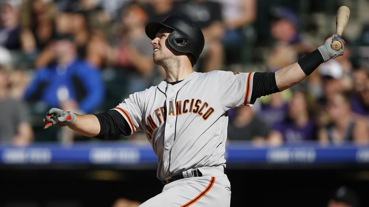 San Francisco Giants Buster Posey follows the flight of his three-run home run off Colorado Rockies relief pitcher Carlos Estevez Saturday, , May 28, 2016, in Denver.