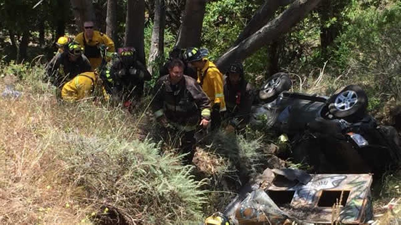 Crews rescue two people after their vehicle went off a cliff in Oakland, Calif. on Sunday, May 29, 2016.