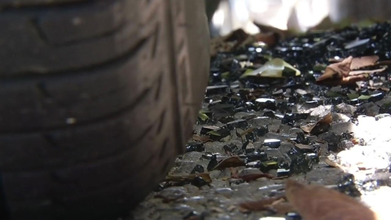 Shattered glass sits on the street at the scene where an FBI agents gun was stolen out of a vehicle in San Francisco.