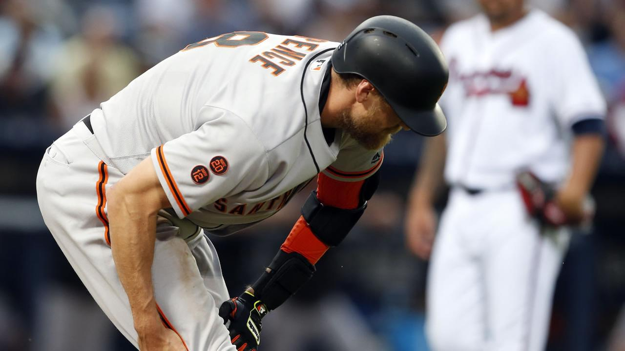 San Francisco Giants Hunter Pence pulls up and grabs his leg during the fourth inning of a baseball game against the Atlanta Braves, Wednesday, June 1, 2016, in Atlanta.