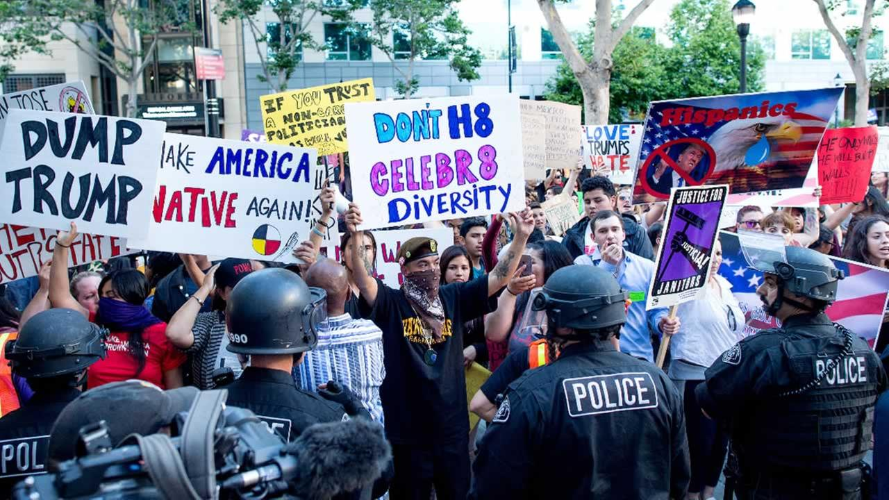 Police form a line to contain protesters outside a campaign rally for Republican presidential candidate Donald Trump on Thursday, June 2, 2016, in San Jose, Calif.