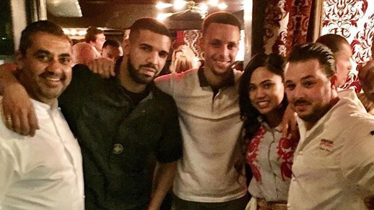 This image shows the rapper Drake, Stephen Curry and wife Ayesha Curry at the opening of International Smoke, a pop-up restaurant in San Francisco on June 3, 2016.