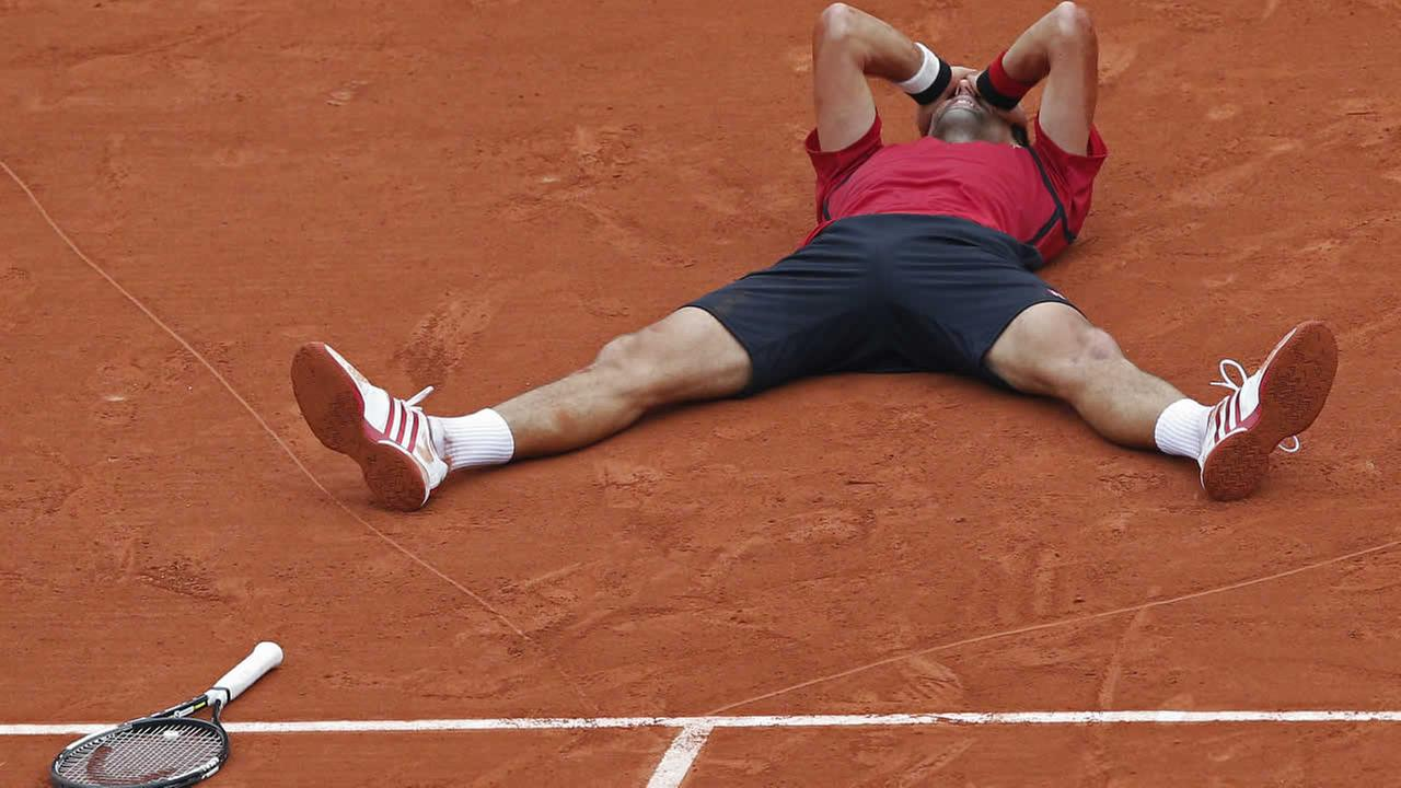 Serbias Novak Djokovic celebrates winning the final of the French Open tennis tournament against Britains Andy Murray at the Roland Garros stadium in Paris, France, Sunday, June 5, 2016.