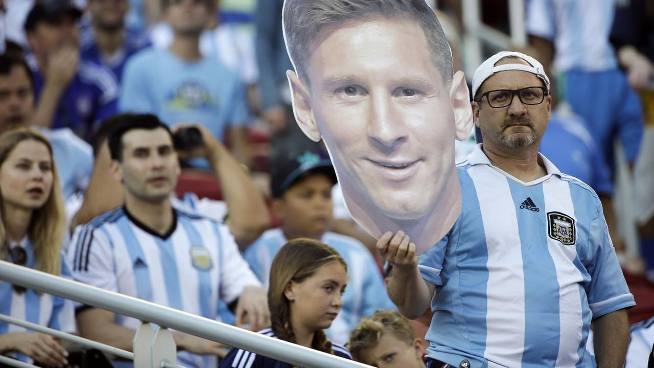 A fan holds a cutout figure of Argentinas Lionel Messi before the start of a Copa America Centenario Group A soccer match between Argentina and Chile at the Levis Stadium in Santa Clara, Calif., Monday, June 6, 2016.