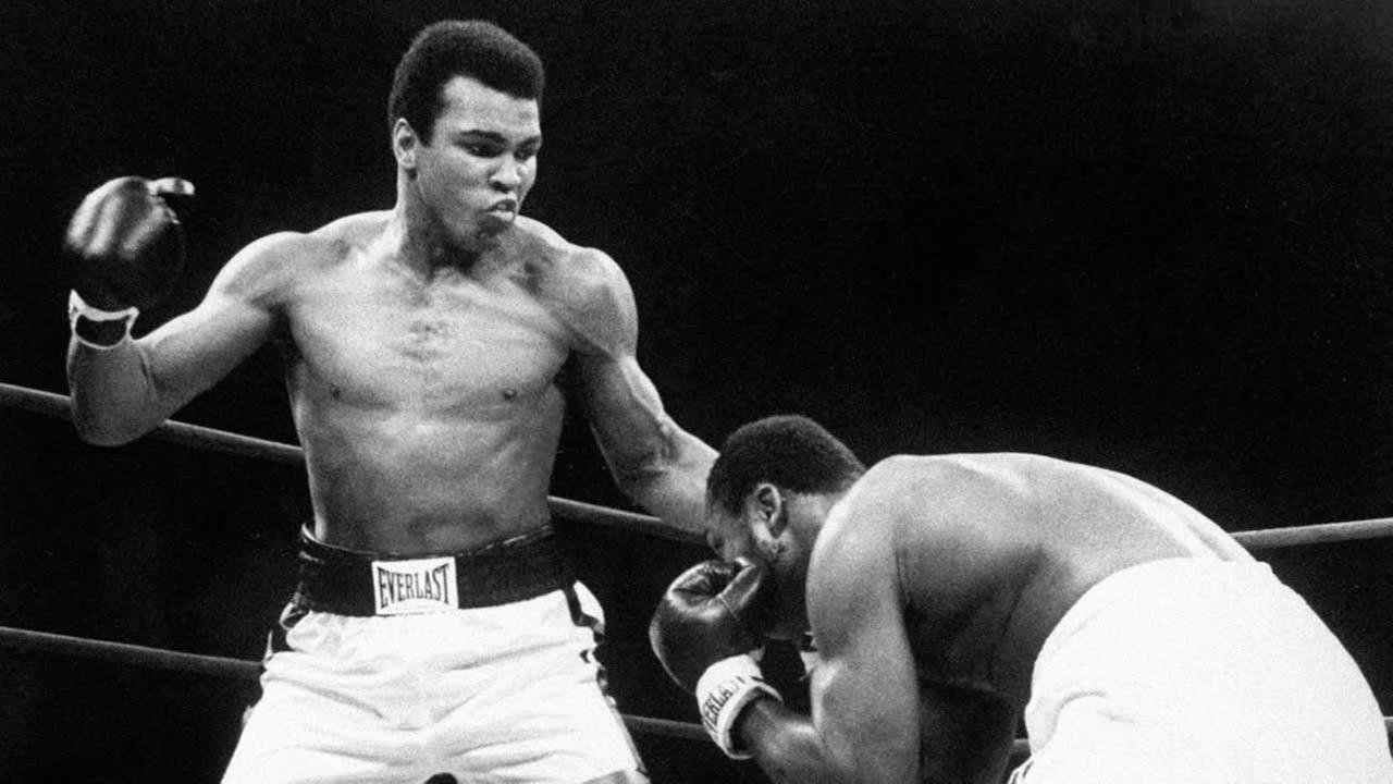 In this Jan. 28, 1974, file photo, Muhammad Ali throws a punch at Joe Frazier, right, in the twelfth round during their bout at Madison Square Garden in New York.