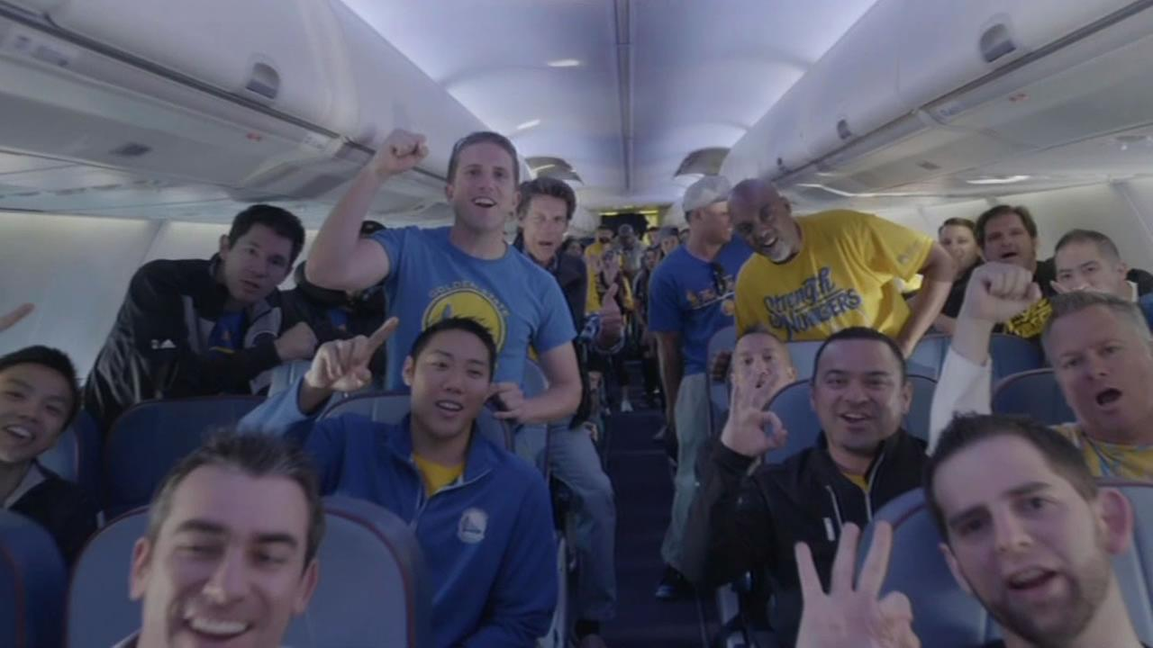 This image shows Golden State Warriors employees inside a plane on their way to Cleveland for Game 4 of the NBA Finals on June 10, 2016.