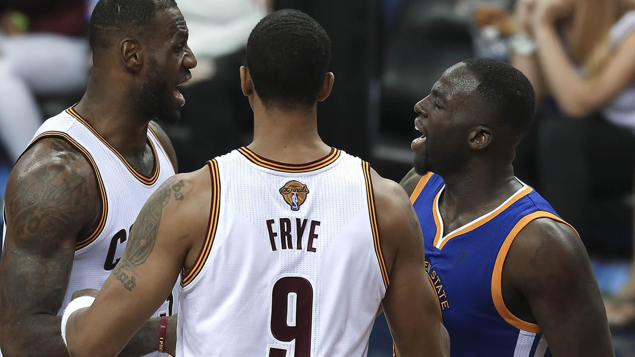 Warriors Draymond Green and Cavalier LeBron James argue during Game 4 of basketballs NBA Finals in Cleveland on June 10, 2016.(AP Photo/Ron Schwane)