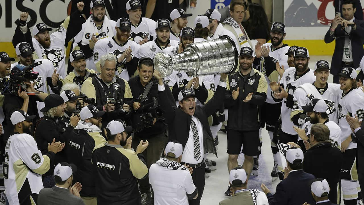 Pittsburgh Penguins head coach Mike Sullivan raises the Stanley Cup after Game 6 of the Stanley Cup Finals against the San Jose Sharks Sunday, June 12, 2016, in San Jose, Calif.
