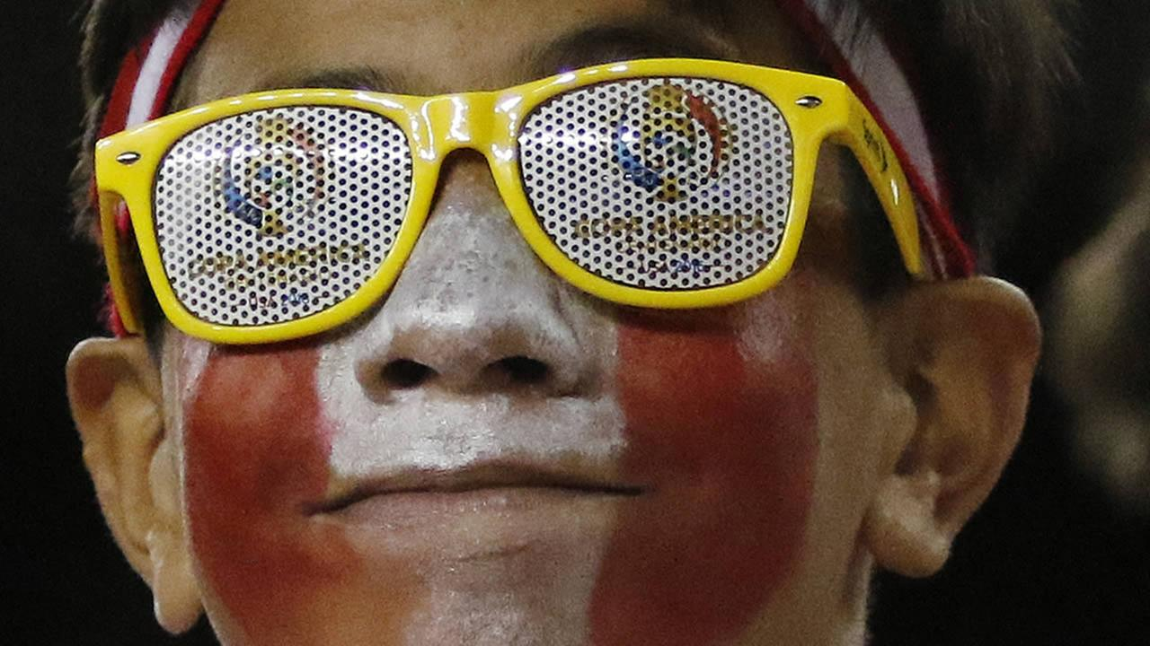 A Peru supporter wears souvenir glasses as he waits for the start of a Copa America Group B soccer match between Brazil and Peru on Sunday, June 12, 2016, in Foxborough, Mass.