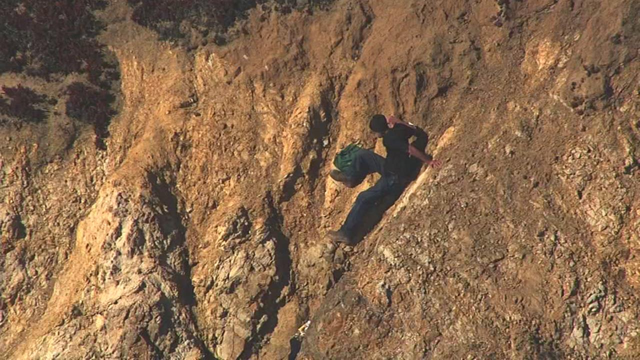 Emergency crews rescue a person trapped on a cliff near Sutro Heights Park in San Francisco, Calif. on Wednesday, June 15, 2016.