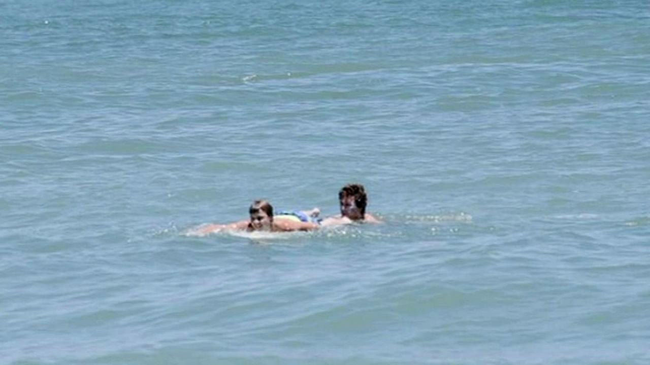 Third Eye Blind frontman Stephen Jenkins is seen rescuing a boy who nearly got caught by a rip current on the Carolina coast, Thursday, June 16, 2016.