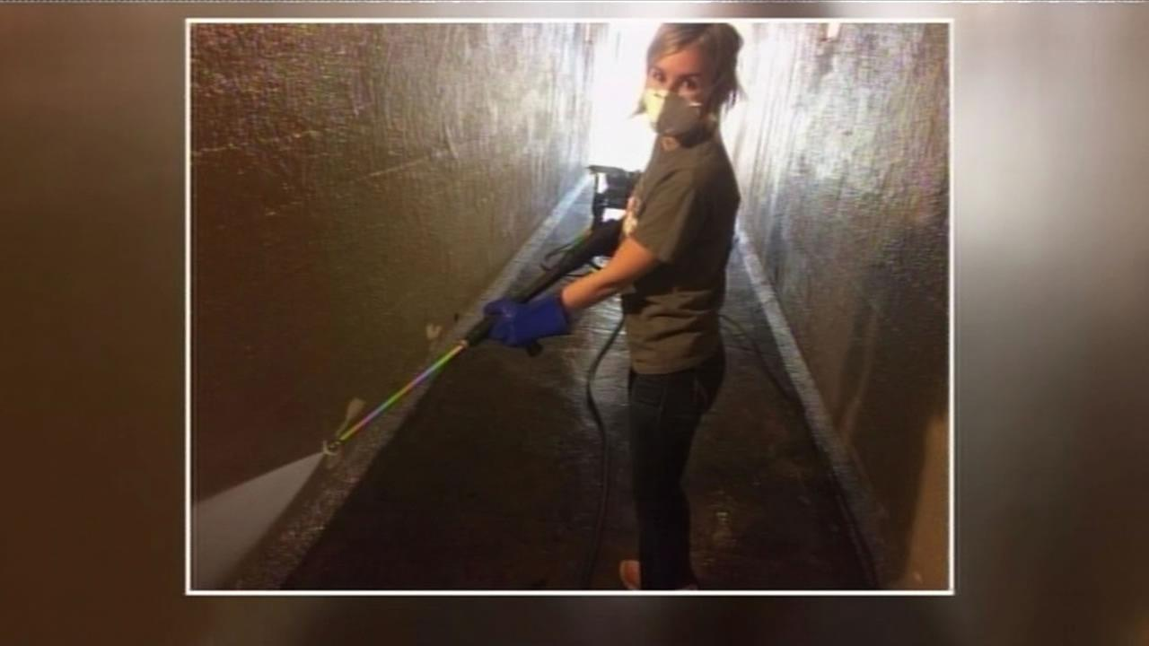 This undated image shows Taylor Thomas working to clean a pedestrian tunnel in San Jose, Calif.