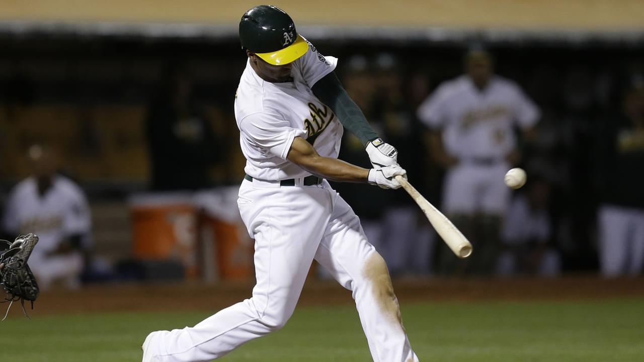 Oakland Athletics Marcus Semien swings for a two run triple hit off Milwaukee Brewers Blaine Boyer in the seventh inning Tuesday, June 21, 2016, in Oakland, Calif.