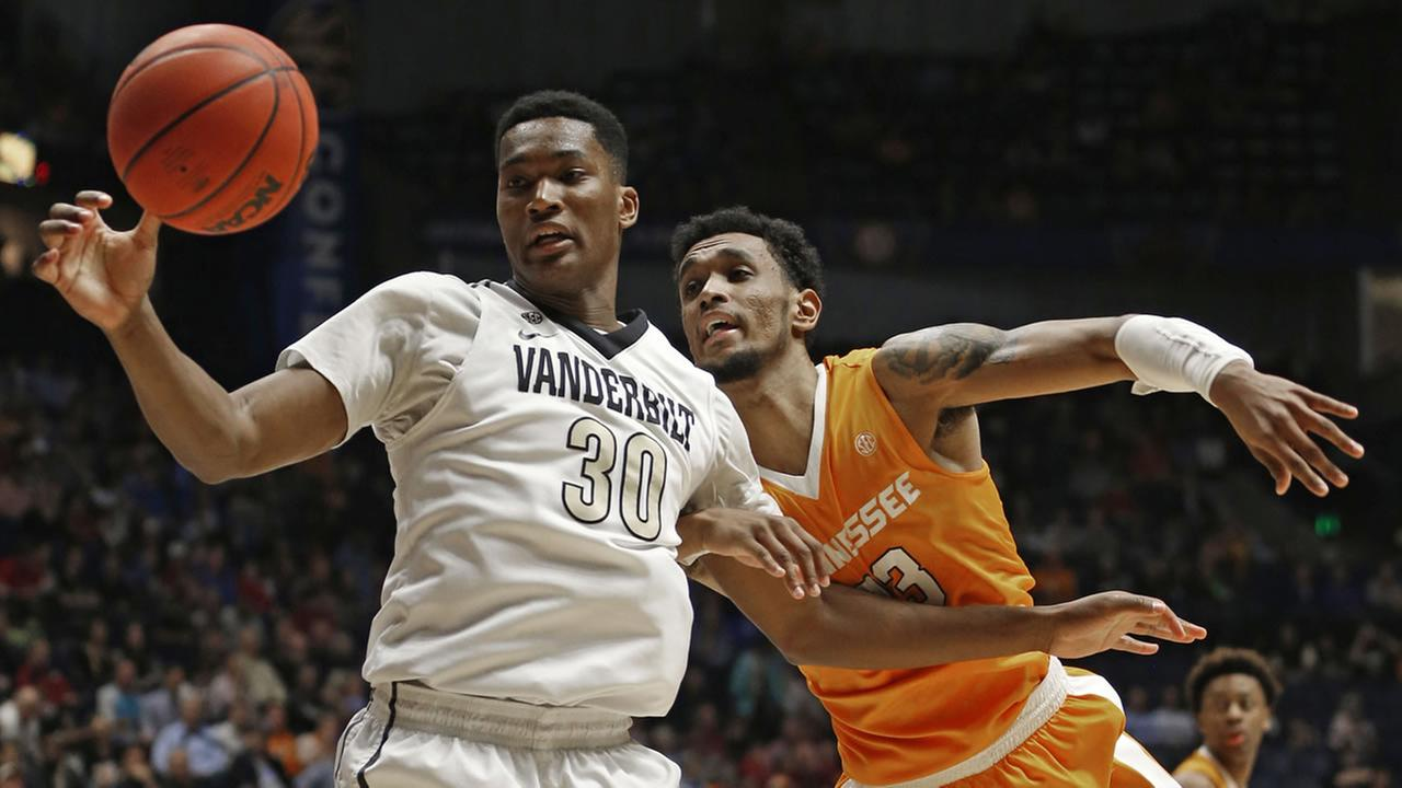 Vanderbilts Damian Jones (30) and Tennessees Derek Reese (23) battle for a rebound during the first half of an NCAA college basketball game Nashville, Tenn., March 10, 2016.