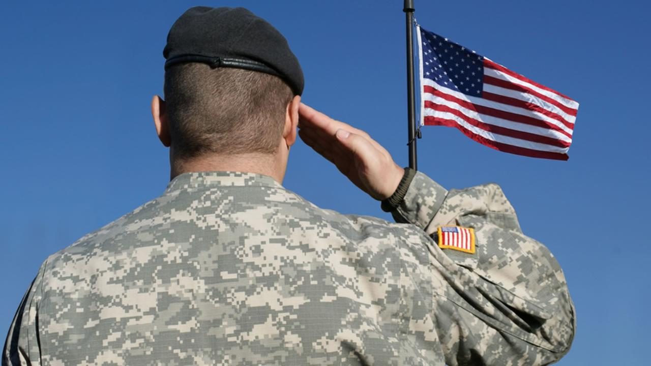 An American soldier saluting the flag of the United States of America.