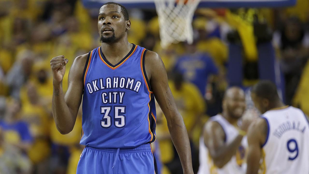 Oklahoma City Thunder forward Kevin Durant (35) reacts during the second half of Game 7 of the NBA basketball Western Conference finals against the Golden State Warriors in Oakland, Calif., Monday, May 30, 2016. (AP Photo/Marcio Jose Sanchez)