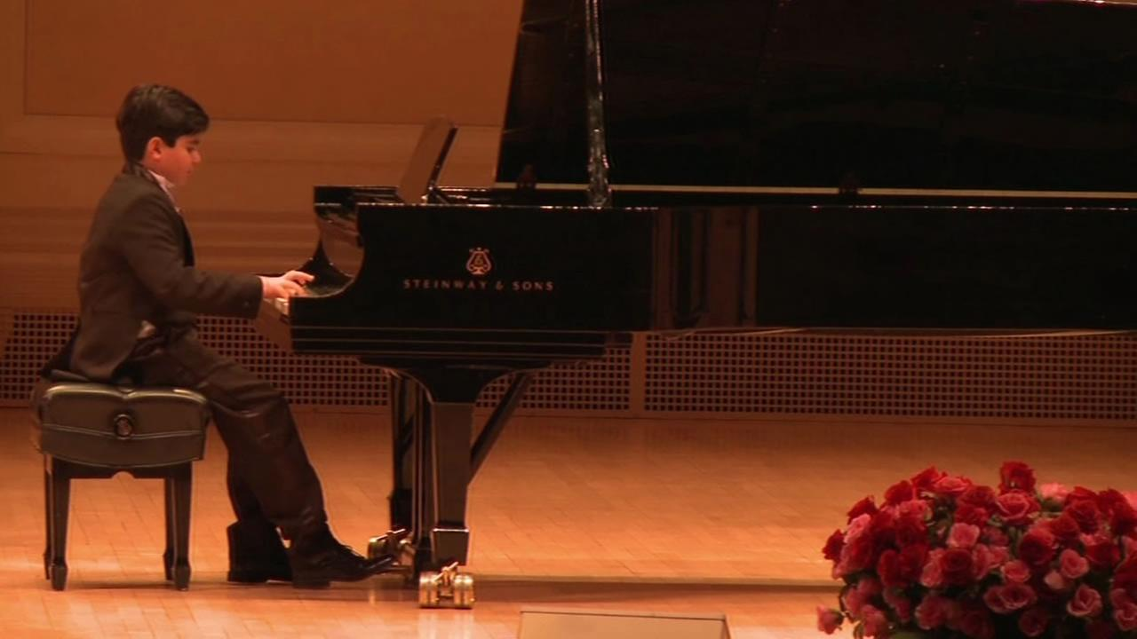 This image shows 10-year-old Connor Roham playing piano at Carnegie Hall.
