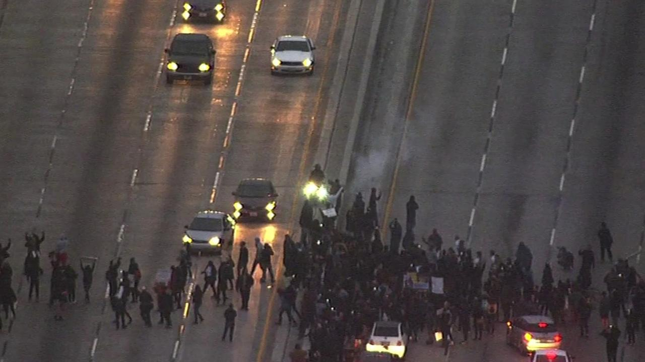 This image shows protesters demonstrating against police violence in Oakland, Calif. marching onto Interstate 880 near Broadway on July 7, 2016.