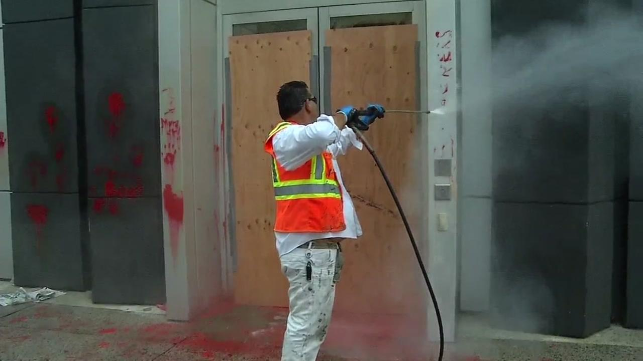 Crews clean up in Oakland, Calif. on Friday, July 8, 2016 following an anti-police protest the night before.