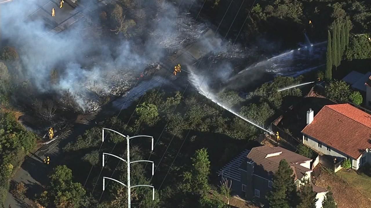 This image shows a structure and vegetation fire in Antioch on July 8, 2016.