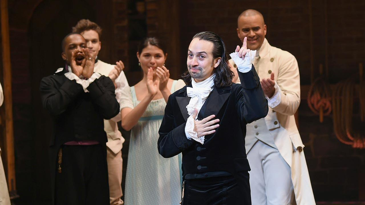 Actors Leslie Odom Jr., left, Phillipa Soo, and Christopher Jackson take a bow with actor and Hamilton creator Lin-Manuel Miranda during his final performance curtain call at the Richard Rogers Theatre on Saturday, July 9, 2016, in New York.