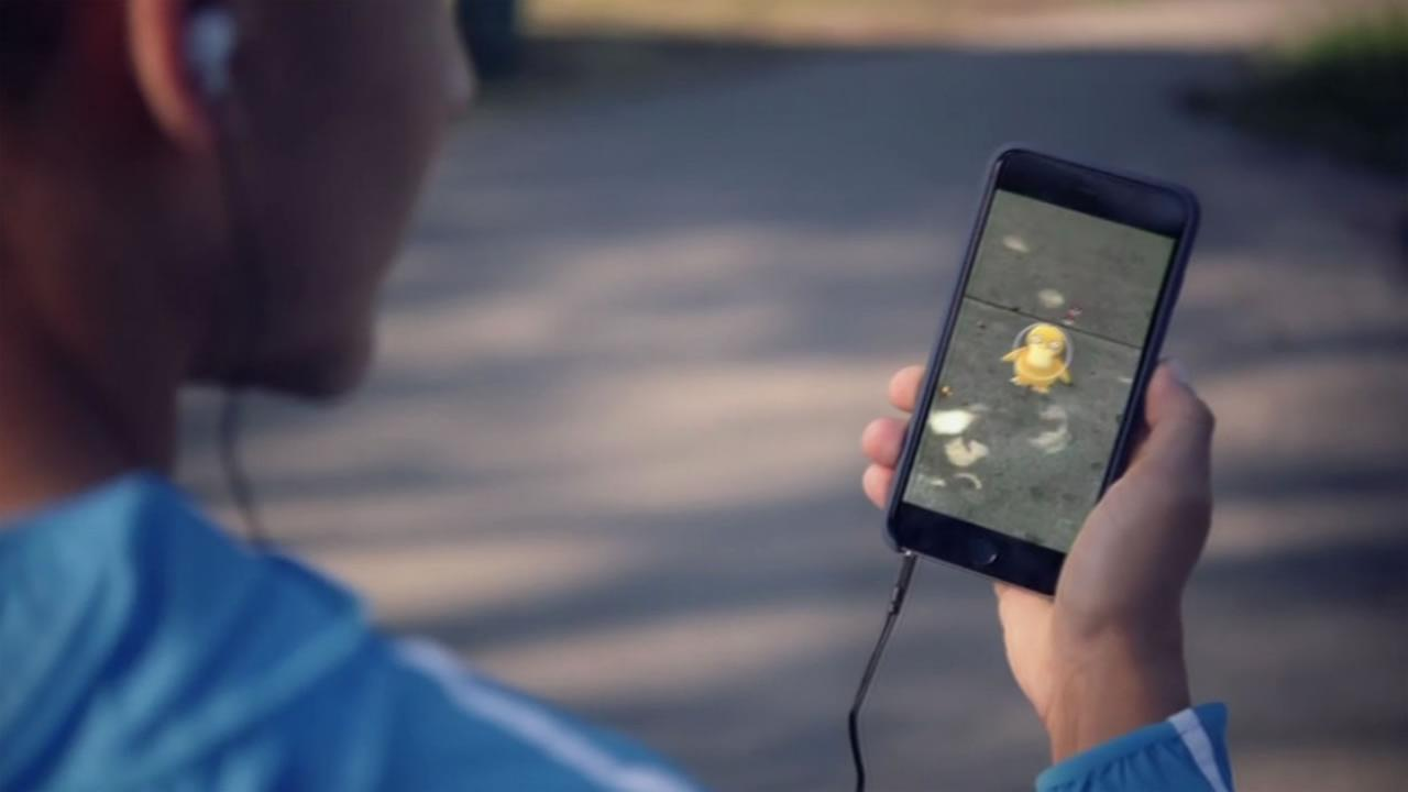 A Pokemon Go user plays the game on his cellphone.