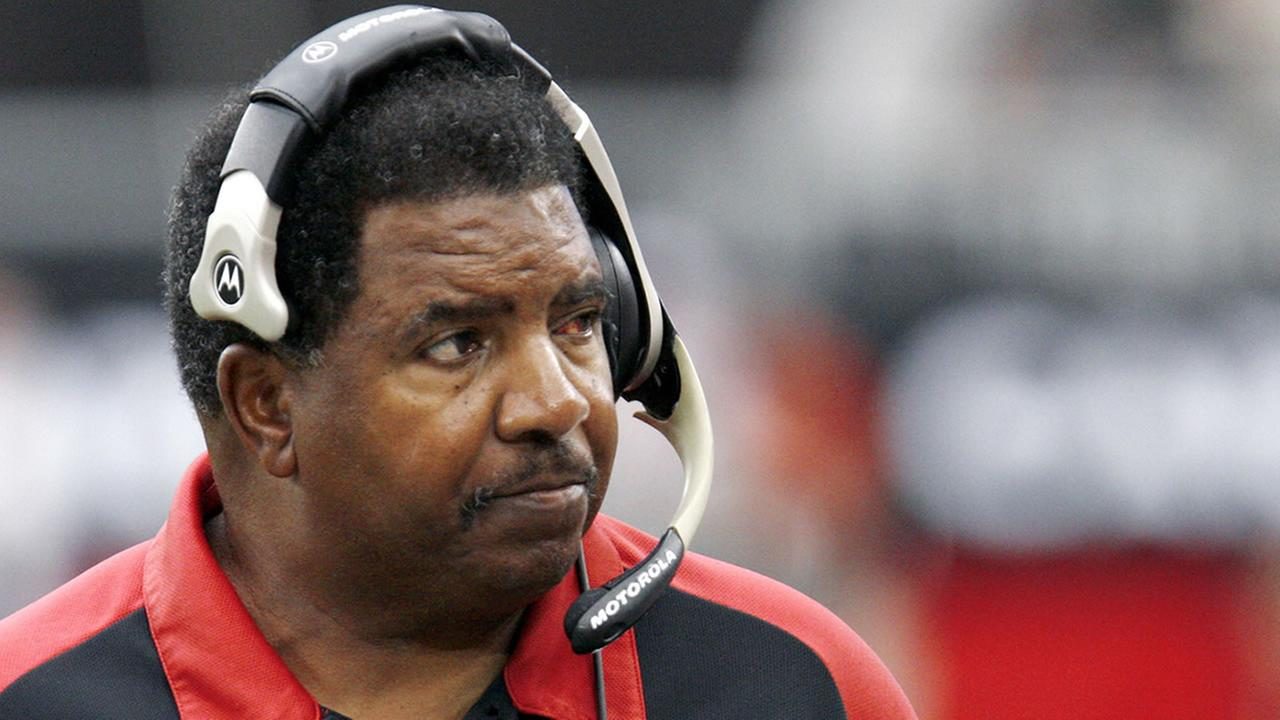 In this Sept. 24, 2006 file photo, Arizona Cardinals head coach Dennis Green watches from the sidelines during the first half of an NFL game against the St. Louis Rams in Glendale, Ariz.