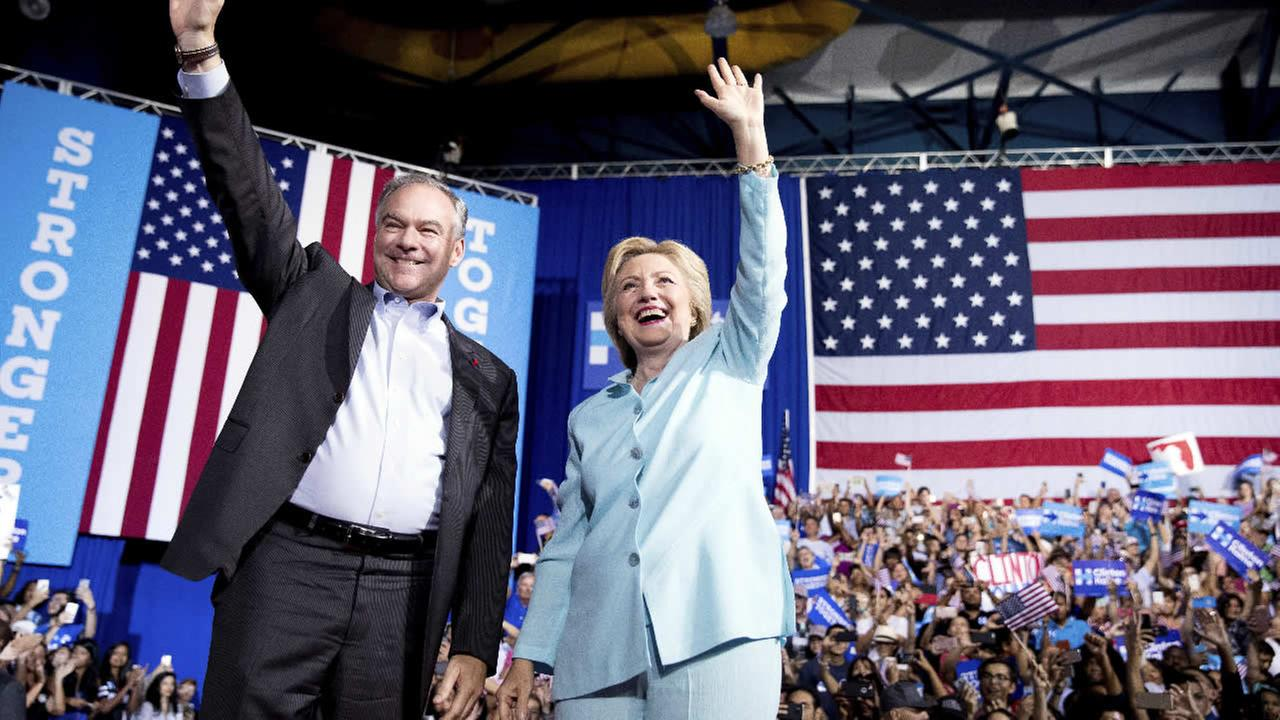 Democratic presidential candidate Hillary Clinton and Sen. Tim Kaine, D-Va., arrive at a rally at Florida International University Panther Arena in Miami, Saturday, July 23, 2016. Clinton has chosen Kaine to be her running mate.
