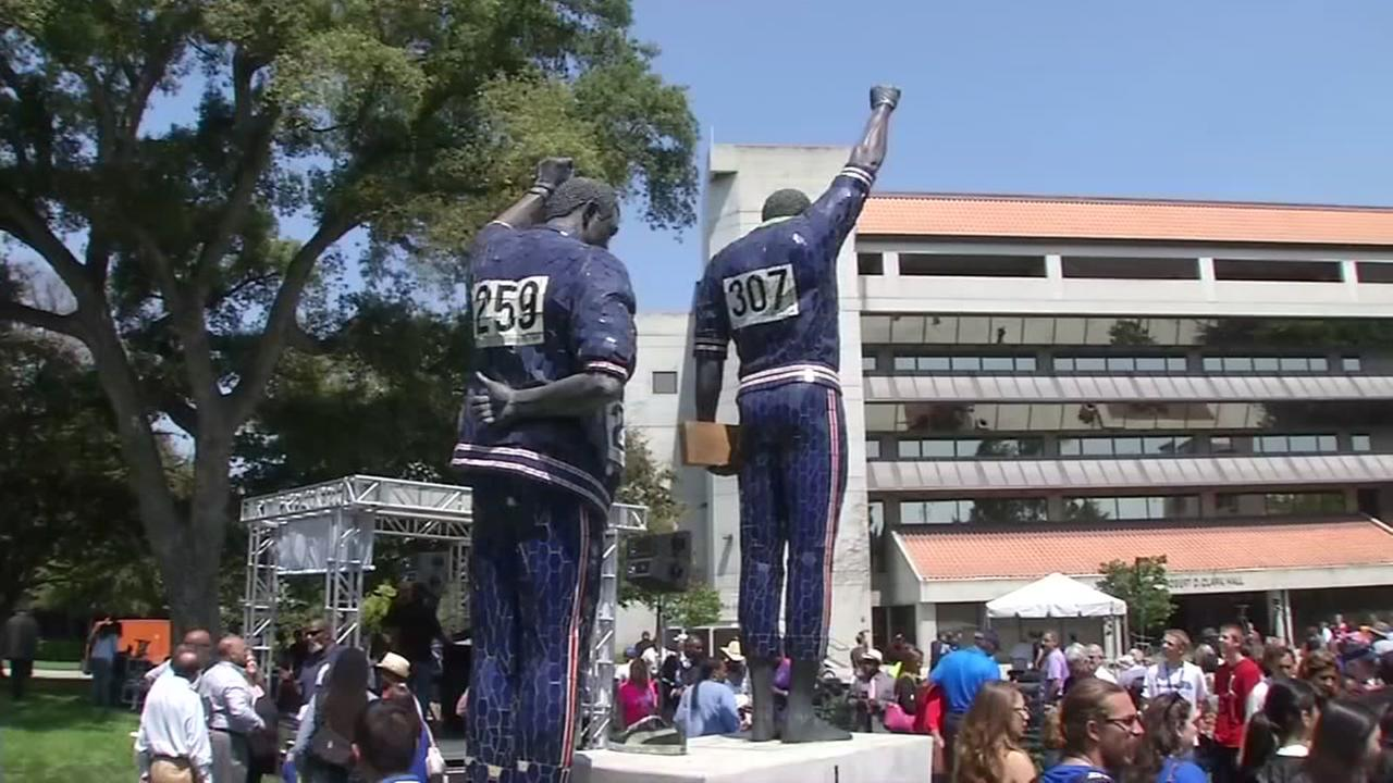 A statue of Olympians Tommie Smith and John Carlos is seen on the San Jose State University campus in San Jose, Calif. on Monday, August 1, 2016.