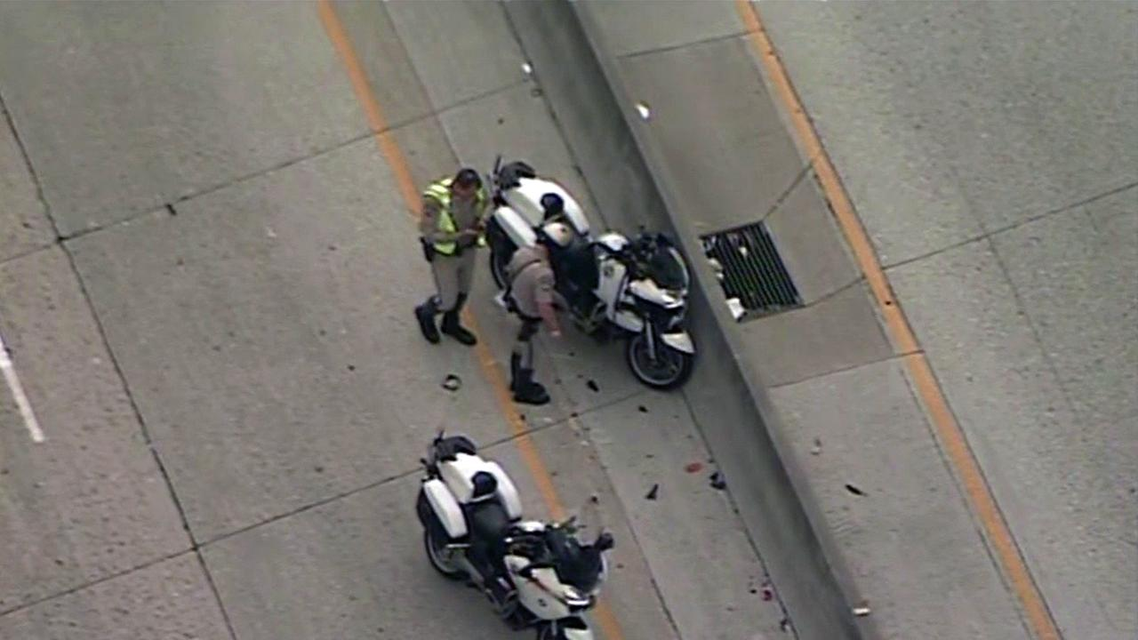CHP investigate motorcycle crash involving officer in San Jose, Thursday, August 4, 2016.