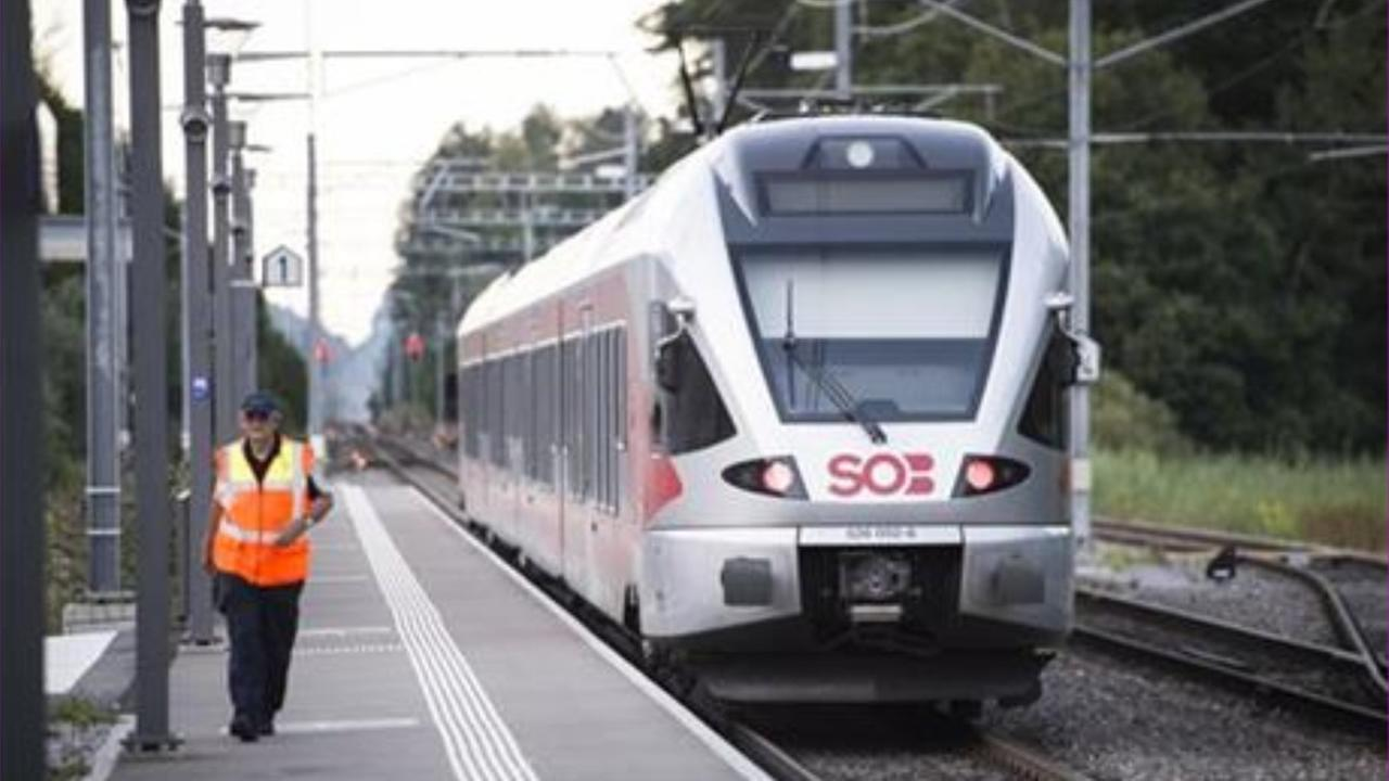 The train stands at the station after a man attacked other passengers aboard the train at Salez, Switzerland, on Saturday, Aug. 13, 2016.