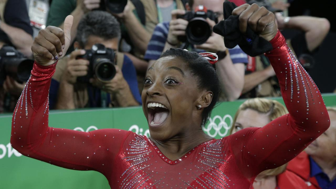 United States Simone Biles celebrates after her winning gold in the vault during the artistic gymnastics womens apparatus final at the 2016 Summer Olympics in Rio de Janeiro, Brazil, Sunday, Aug. 14, 2016.