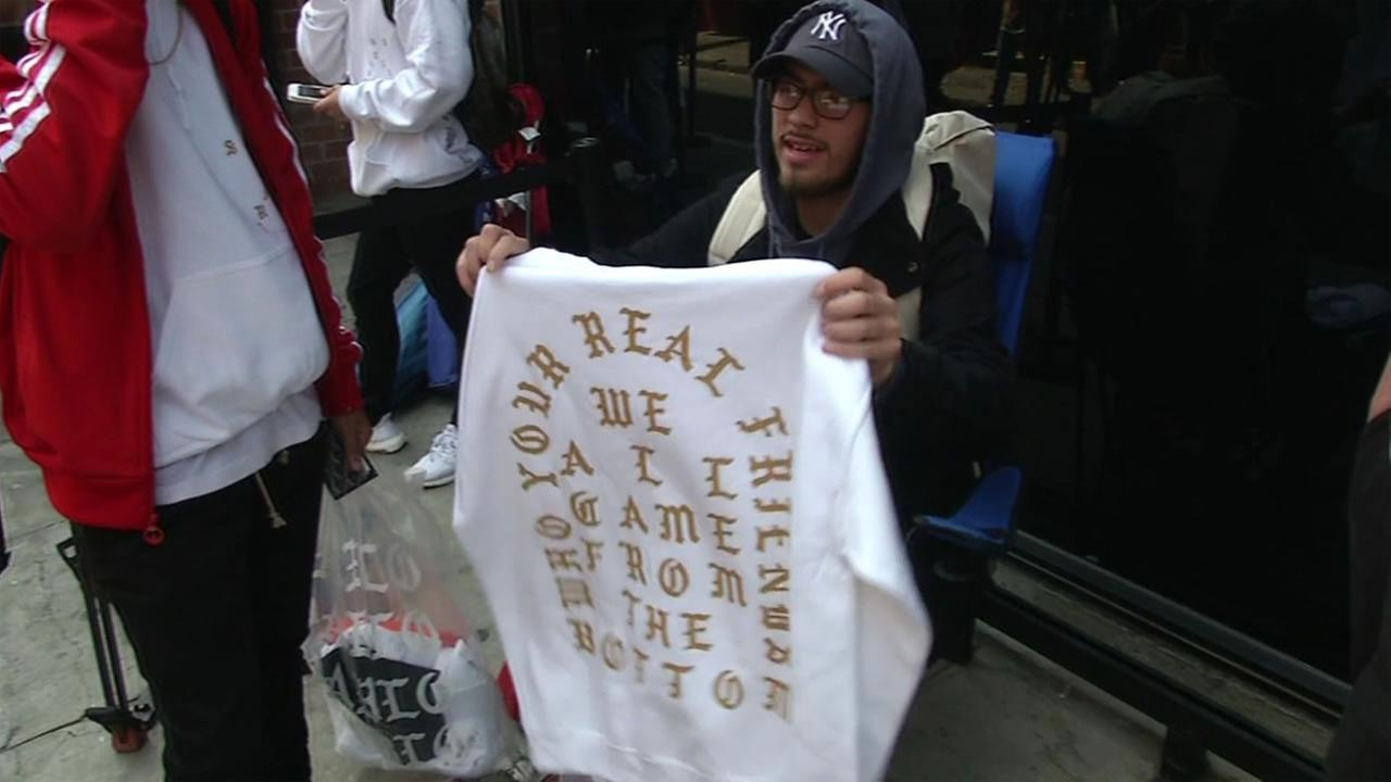 A customer shows off a sweatshirt he purchased at the Kanye West pop-up shop in San Franciscos Chinatown on Friday, August 19, 2016.