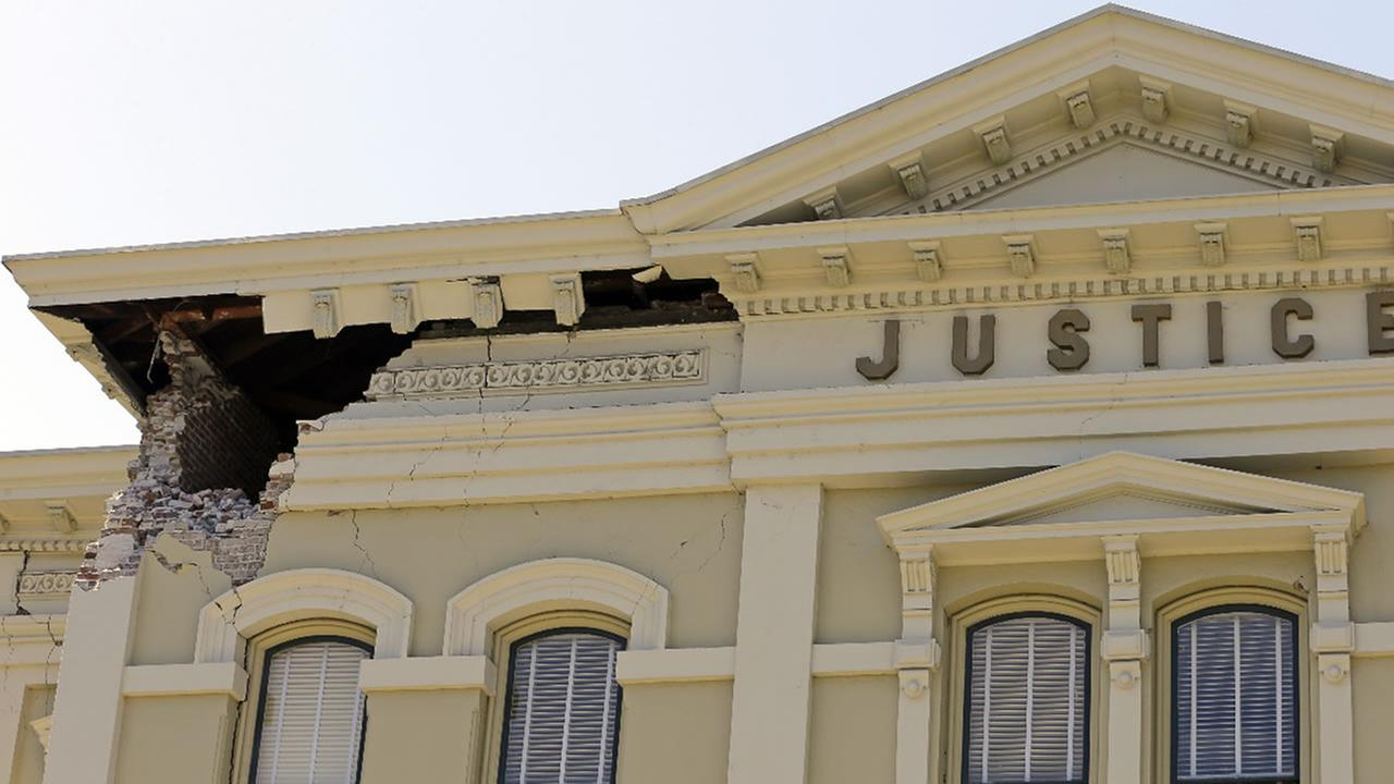 In this file photo from Aug. 24, 2014, an upper corner of the Napa County Courthouse displays structural damage after an earthquake in Napa, Calif.