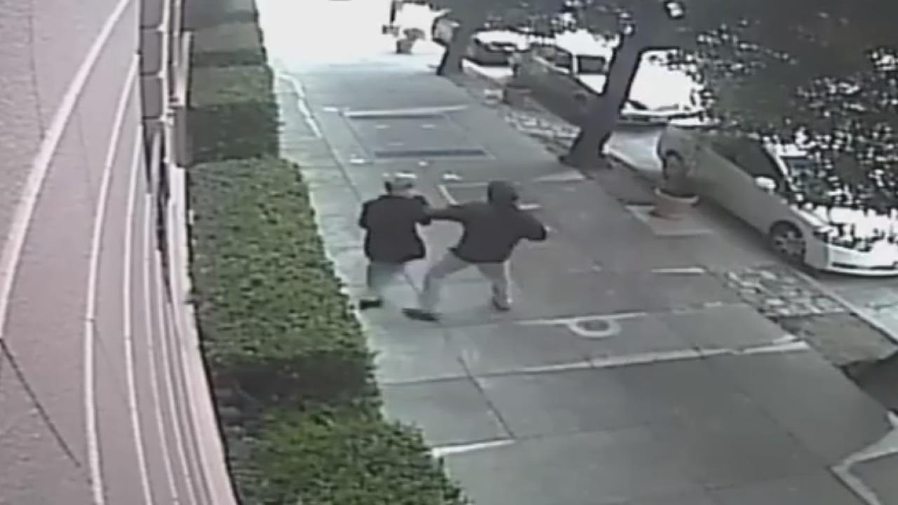 This image from surveillance video shows a man attacking a woman in San Francisco on Saturday, August 20, 2016.