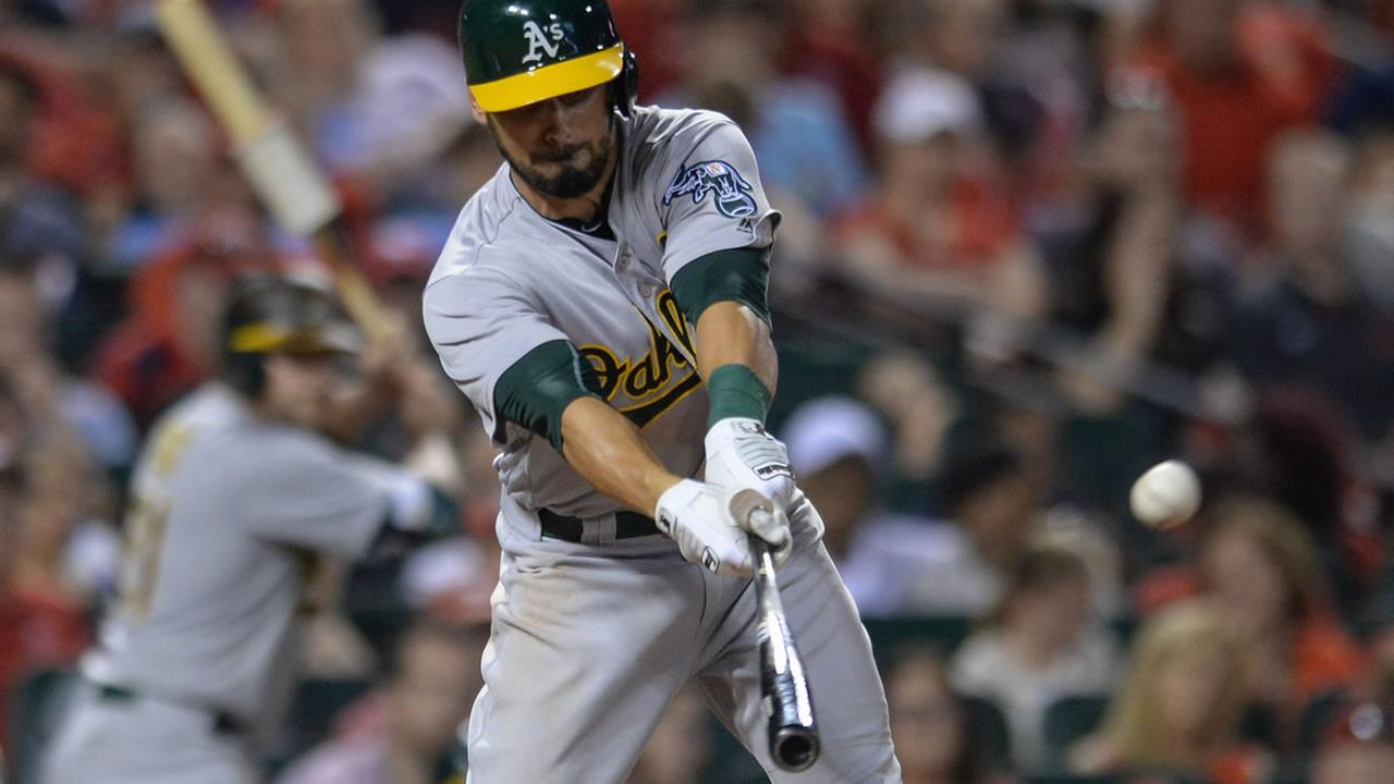 Oakland Athletics Brett Eibner (39) hits a sacrifice fly during the eighth inning of a baseball game against the St. Louis Cardinals on Saturday, Aug. 27, 2016, in St. Louis.