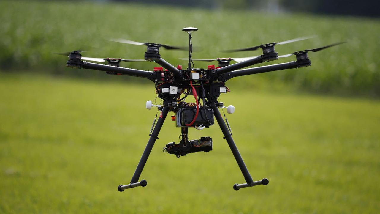 FILE - In this June 11, 2015, file photo, a hexacopter drone is flown during a drone demonstration in Cordova, Md.
