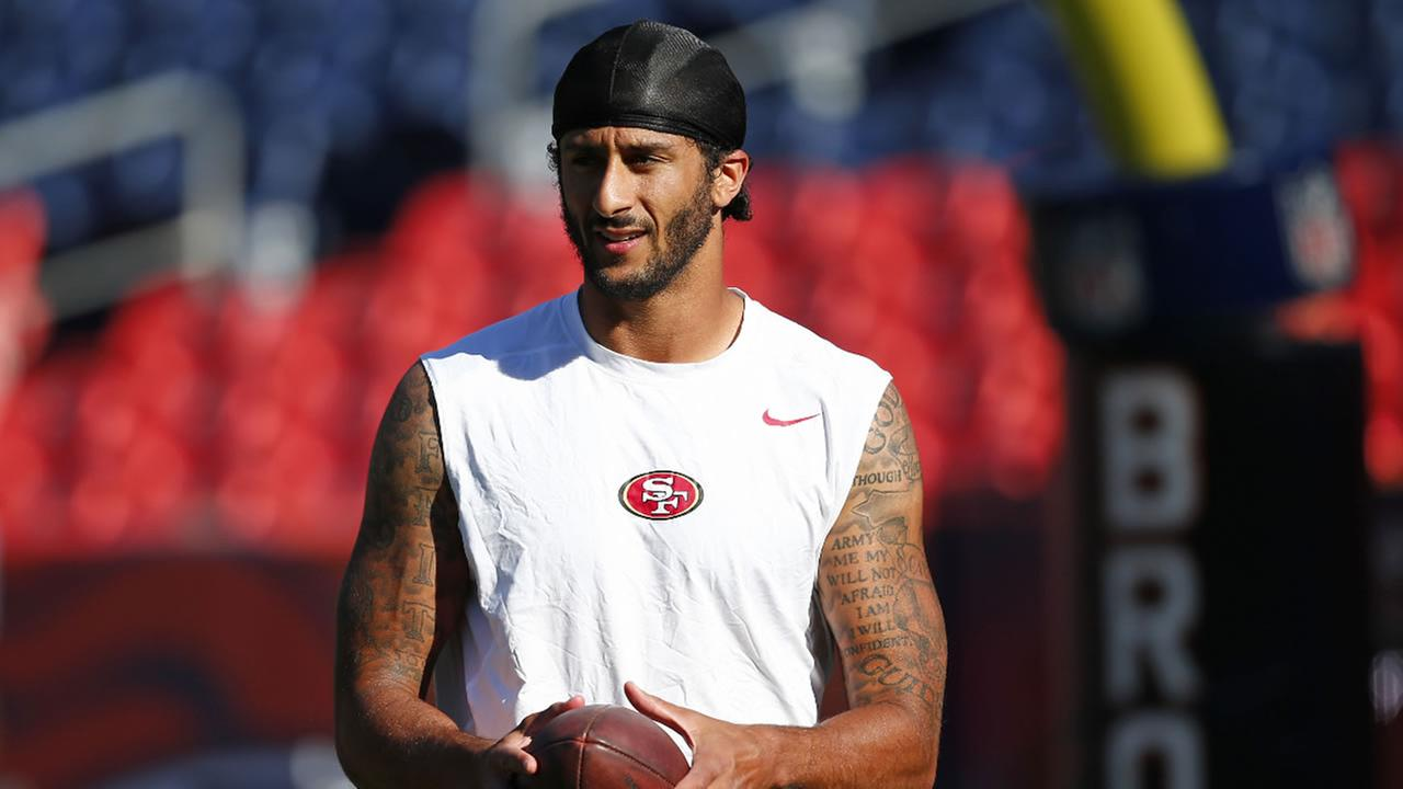 Colin Kaepernick holds the football during warmups before a preseason NFL football game against the Denver Broncos, Saturday, Aug. 20, 2016, in Denver.